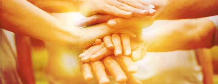 image of hands, banding together
